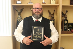 Director of Speech and Debate Receives Prestigious Local Award for Service