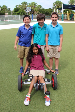 Fifth grade students test drive bicycle they engineered