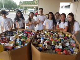 Upper School Students Participate in Stamp Out Hunger Service Event