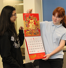 Two girls holding calendar